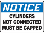 A photograph of a 01731 notice cylinders not connected must be capped osha signs.
