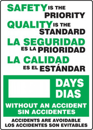 A photograph of a 06300 bilingual english/spanish write-a-day dry erase safety scoreboards.