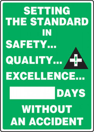 A photograph of a 06306 setting the standard in safety quality excellence __ days without an accident write-a-day dry erase safety scoreboards.