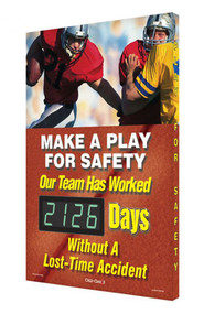 A photograph of a 06342 digi-day® 3 electronic scoreboard: make a play for safety - our team has worked ____ days without a lost-time accident, football style 1.