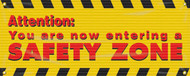 Drawing of yellow and black safety banner with the red text Attention: You are now entering a safety zone.