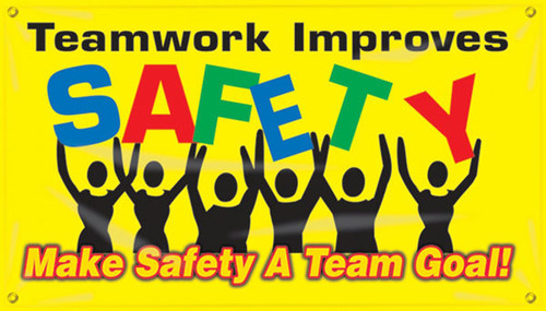 """Picture of Workplace Safety Banner that features a colorful yellow background, and wording of """"Teamwork Improves Safety"""" in colorful green, red, black, and blue text being held up by a team of stick figures. Below is the wording """"Make Safety A Team Goal!"""" in bold yellow and red text."""