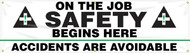 """Picture of Workplace Safety Banner that features a professional white background and the image of a two large ANSI-style safety crosses flanking the wording """"On The Job Safety Begins Here"""" in bold black text. Below is displayed the wording """"Accidents Are Avoidable""""."""