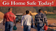 """Picture of Workplace Safety Banner that features picture of three men headed off after a hard day of work. They are all carrying their hard hats in hand as they are off the worksite now. Along the top is red stripe that has eye catching white text that reads """"Go home safe today!""""."""
