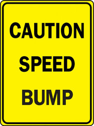 A photograph of a yellow and black 06251 speed bump sign, reading caution speed bump.