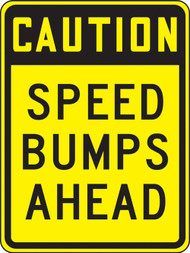 A photograph of a yellow and black 06252 speed bump sign, reading caution speed bumps ahead.