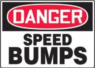 A photograph of a 06255 osha sign: danger speed bumps.