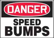 A photograph of a black and white 06255 OSHA sign, reading danger speed bumps.