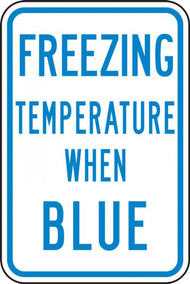A photograph of a blue and white 11070 temperature indicator sign, reading freezing temperature when blue.