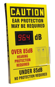 """A photograph of a yellow 11102 OSHA caution decibel meter sign with 20"""" l x 12"""" w dimensions,  and ear plug dispenser."""