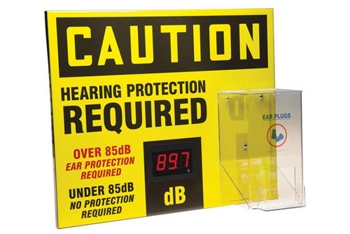 """A side photograph of a yellow and black 11103 OSHA caution decibel meter sign, with 20"""" l x 24"""" w dimensions, and ear plug hopper dispenser."""
