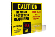 """A photograph of a yellow and black 11111 OSA caution decibel meter sign, with dimensions 20"""" x 24"""", and ear plug dispenser."""