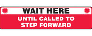 """A photograph of a red and white 11204 social distance floor sign, reading wait here until called to step forward, with dimensions 6"""" x 24"""", and stop icons."""
