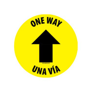 A photograph of the yellow and black 05412 one way, una via, with arrow icon, removable social distance floor sign.