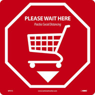 A photograph of the red and white 05425 Please Wait Here | Practice Social Distancing removable social distance floor sign, with cart graphic.