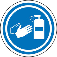 A photograph of a blue and white 11251 pavement print sign, with sanitize hands symbol.
