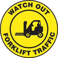 A photograph of a yellow and black 11253 pavement print sign, reading watch out forklift traffic, with forklift graphic.