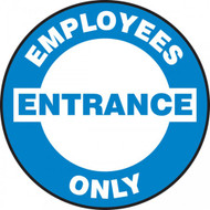 A photograph of a blue and white 11254 pavement print sign, reading employees entrance only.