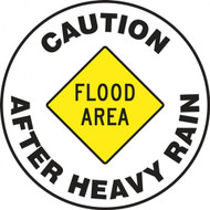 "This sign features a yellow caution sign in the center reading ""Flood Area"", and text around the border reading ""Caution After Heavy Rain""."