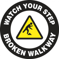 "This black and white sign features a yellow caution sign in the center with the image of a figure tripping over an obstacle. White text on a black border reads ""Watch Your Step, Broken Walkway"". Use for areas with broken and dangerous walkways."
