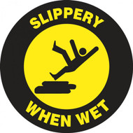 "This black and yellow sign features the image of a person slipping on a surface with the text ""Slippery When Wet."" Use for areas that become slippery or wet frequently to prevents falls."