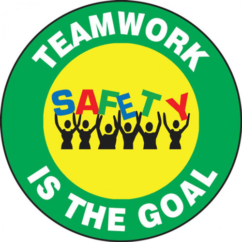 """This colorful green and yellow sign features the text"""" Teamwork Is The Goal"""". The center features the image of a group of people holding up the word """"Safety"""" in colorful letters. Use for teambuilding and raising morale."""