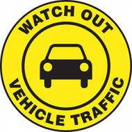 "This black and yellow sign reads ""Watch Out Vehicle Traffic"" in a yellow strip along the border. The center features a black image of a car on a yellow background. Use in areas that see frequent vehicle traffic and usage."