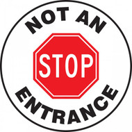 "This white and black sign reads ""Not An Entrance"" around the edge. The center features a large red stop sign that says ""STOP"". Use this to mark roadways as one-way exits only."