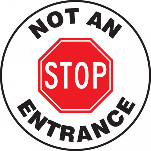 """This white and black sign reads """"Not An Entrance"""" around the edge. The center features a large red stop sign that says """"STOP"""". Use this to mark roadways as one-way exits only."""