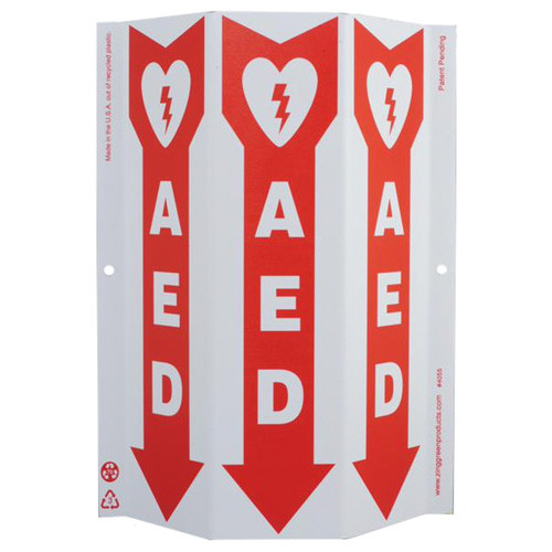 """3-faced white sign features a red down arrow containing a heart/shock icon as well as the text """"AED"""" on each face."""