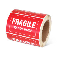 """Photograph of a roll of Speciality Handling Labels, """"Fragile, Do Not Drop"""" ."""