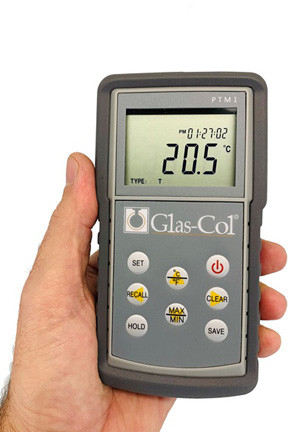 A photograph of a 20075 battery operated handheld digital thermometer for type k, j and t thermocouples in a person's hand.