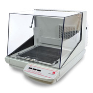 Photograph of 23 kg capacity Ohaus Incubating/Cooling Heavy Duty Orbital Shaker, left facing, lid closed.