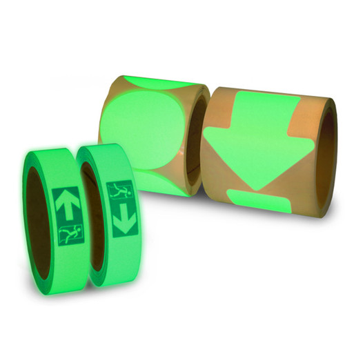 """A photograph showing one roll each of glow in the dark left arrows, right arrows, 3"""" spots, and 4"""" arrows."""