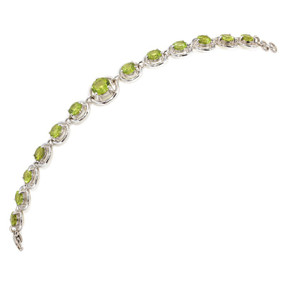 7 1/4 inches in length; 13 Peridot gemstones TCW 12.64 cts - details below