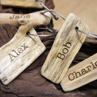 Personalised, engraved driftwood keyrings which are ideal wedding or event place-settings