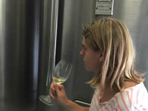 Sophie tasting the wine after tank fermentation