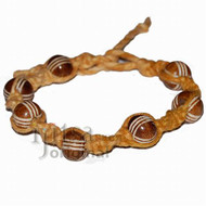 Golden brown twisted hemp bracelet or anklet with brown bone beads throughout