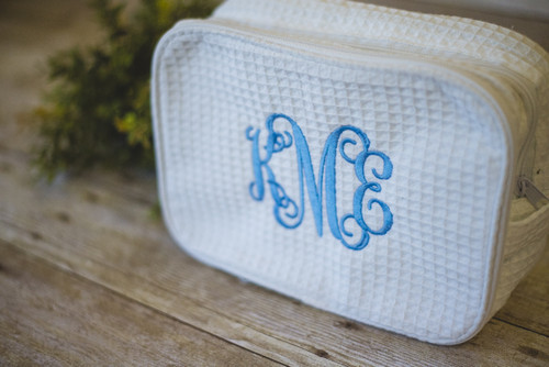 Waffle Weave Cosmetic Bag with Interlocking Monogram in  Oriental Blue