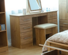 Mya Oak Kneehole Dresser Unit The natural beauty of oak is combined with a stylish blackbar handle