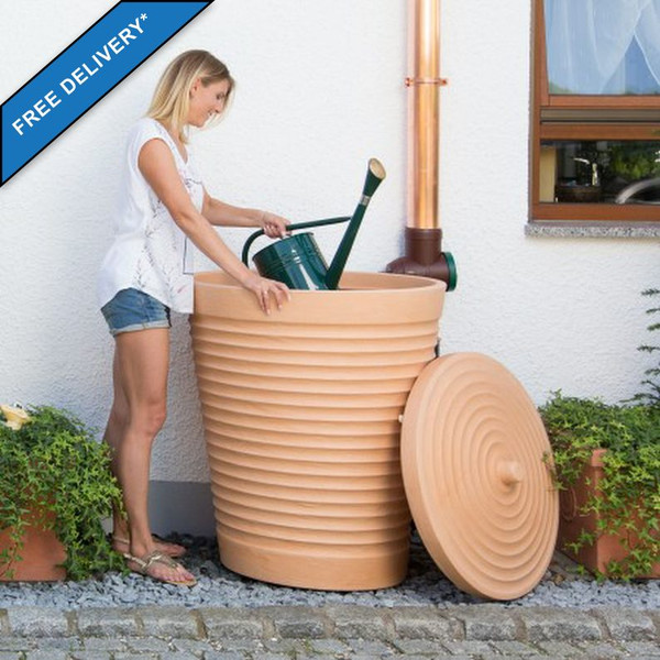 The Tuscan Terracotta Planter Effect water butt has a wide removable lid for easy watering can dunking!