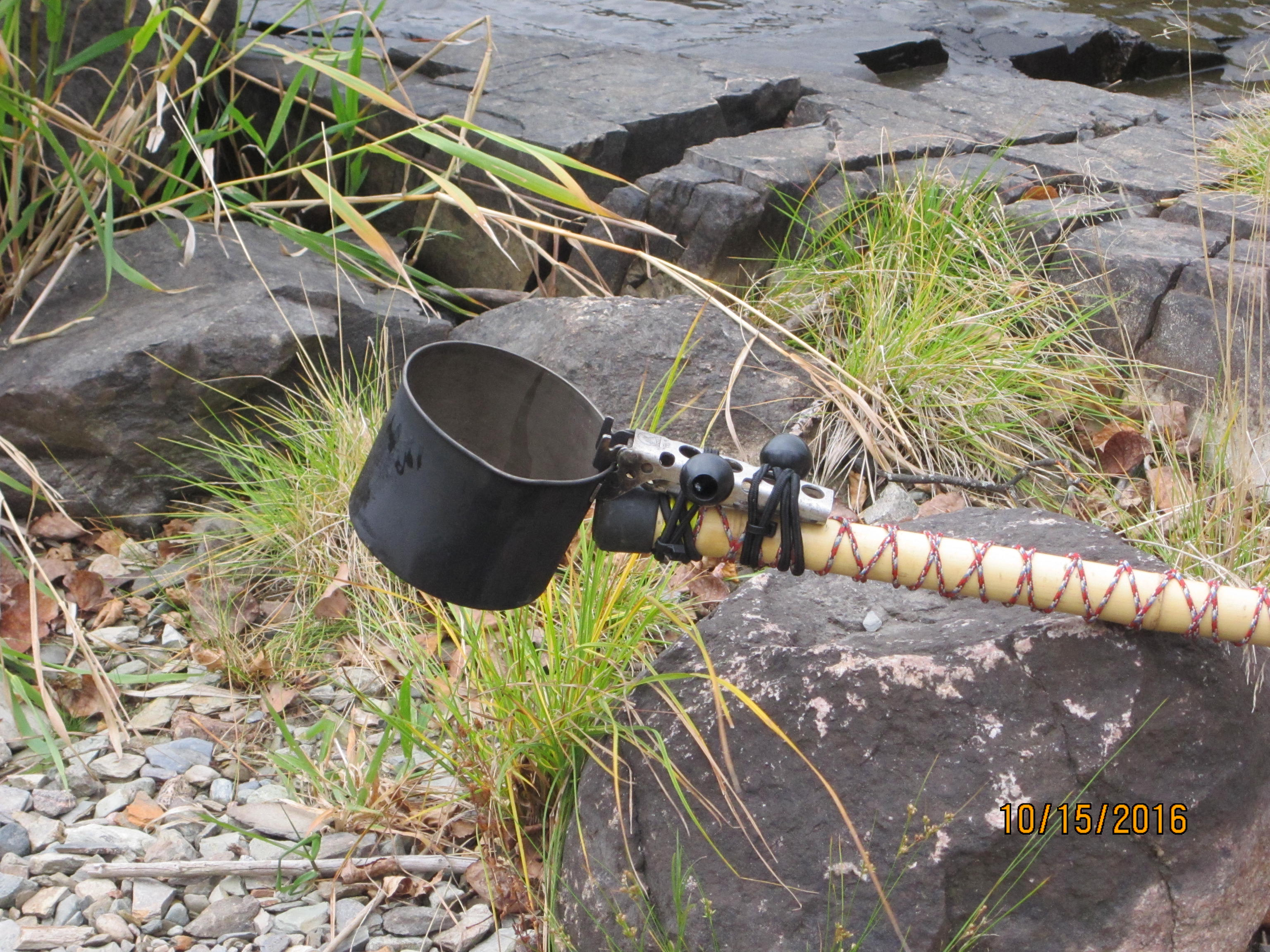 Using a Littlbug bamboo hiking stick to scoop water.