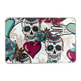 Rectangle tin box with skulls, hearts and flowers.