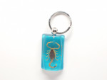 Golden Scorpion Keychain on Blue