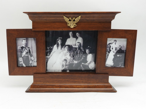 Opens to reveal a family portrait, circa 1914.