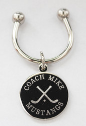 Hockey keychain.  Made of non tarnish high quality nickel plate.  Beautifully engraved round disk with hockey graphic and text arched across the top and bottom.  Makes a great gift for hockey players and coach.  Comes with horseshoe shaped keyring, round split ring keyring, engraved disk and comes boxed in a silver cotton filled gift box.