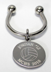 Volleyball keychain.  Made of non tarnish high quality nickel plate.  Beautifully engraved round disk with volleyball graphic and text arched across the top and bottom.  Makes a great gift for players and coach.  Comes with horseshoe shaped keyring, round split ring keyring, engraved disk and boxed in a silver cotton filled gift box.