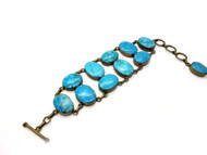 Asian Turquoise Set in Antique Brass Bracelet