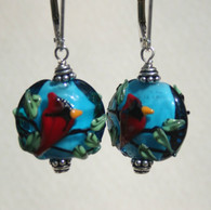 Aqua lampworked lentil shaped earrings with cardinals