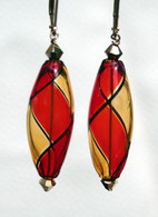 Red and amber olive shaped yin yang design Murano glass earrings